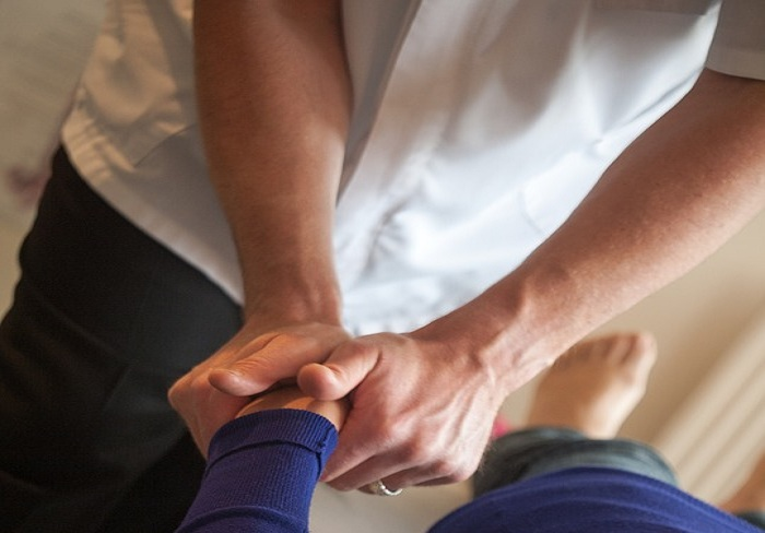Photo of The magical use of hands is the forte of chiropractors in curing pain